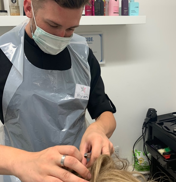 Hair to Ware hair loss consultant in PPE during consultation